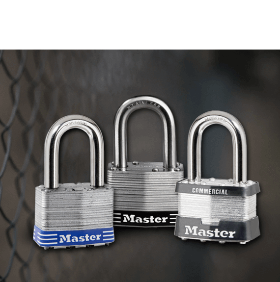 Master Lock laminated padlocks in front of chain link fence.