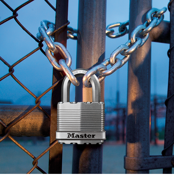 Master Lock magnum padlock on chained fence.