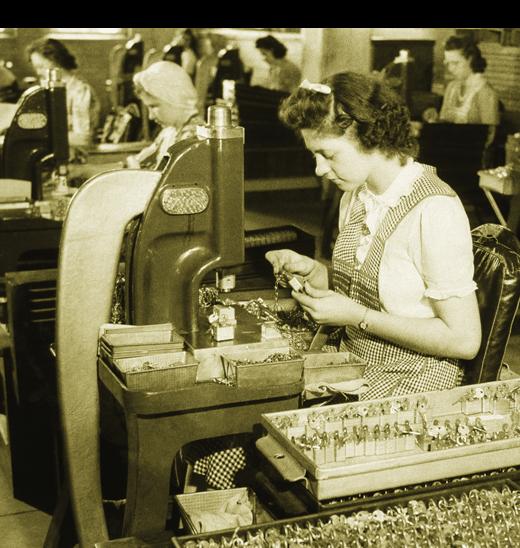 Master Lock worker assembling padlocks in factory during World War II.