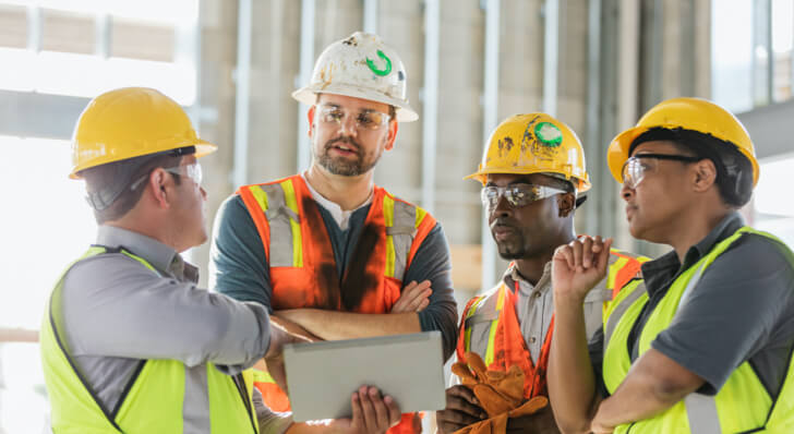 Group of professionals wearing hard hats