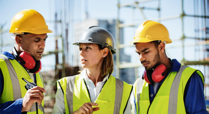 Proup of professionals wearing hard hats