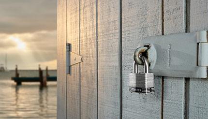 A padlock securing a door at a dock
