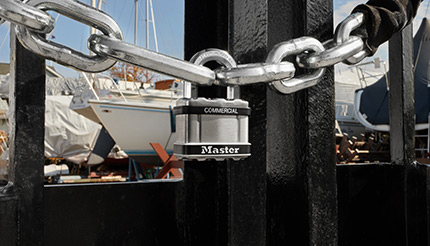 A lock on a chain at a marina