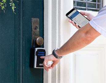 Person opening Bluetooth lockbox using their cellphone