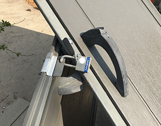Master Lock lock securing a twisted set of doors
