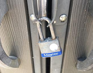 Master Lock lock securing a closed set of doors